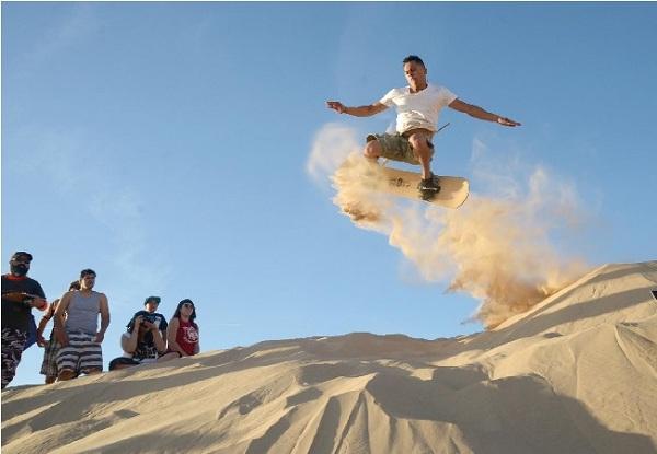 Trượt cát, một trải nghiệm du lịch mới mẻ và thú vị tại Quảng Bình